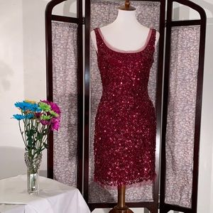 Aidan Mattox red sleeveless sequined party dress.